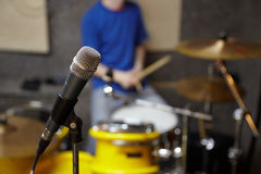 Microphone in studio. drummer in out of focus Stock Photo