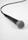 Microphone sur le blanc Photographie stock libre de droits