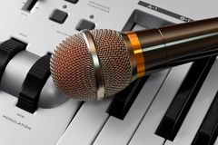 Microphone on synthesizer. High quality dynamic microphone on synthesizer keyboard stock photos