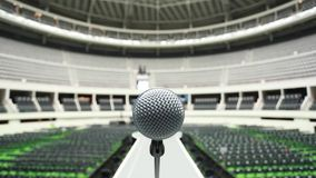 Microphone on top of runway between rows of seats at empty venue before a show Royalty Free Stock Images