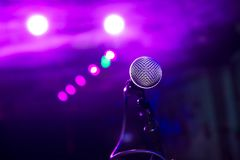 The microphone under the stage lights with bokeh stock image