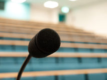 A microphone in a univiersity lecture theatre Stock Images