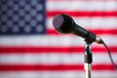 Microphone on US flag background. Royalty Free Stock Image