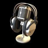 Microphone. Vintage microphone and headphones isolated on black background 3D rendering stock photo