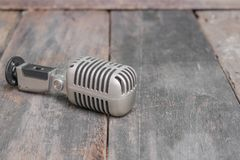 Microphone. Vintage style on the wooden floor background Stock Photos