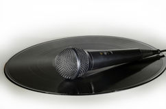 Microphone on a vinyl record album Royalty Free Stock Photography