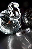 Microphone, vinyl record and Disco Balls, music saturated concep Stock Photos