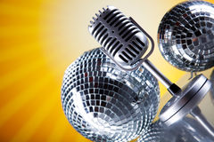 Microphone, vinyl record and Disco Balls, music saturated concep Royalty Free Stock Photography