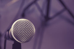 Microphone on wallpaper  background. Stock Images