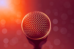 Microphone on wallpaper and flare  light,bokeh background. Royalty Free Stock Photos