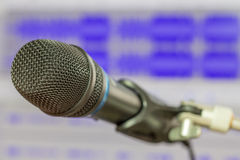 Microphone with waveform blurry background Royalty Free Stock Photography
