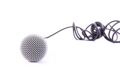 Microphone on white. A front view of a microphone and cable on a white background royalty free stock photo