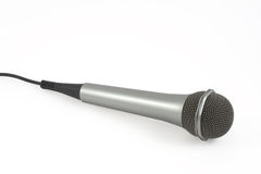 Microphone On A White Backgrou. Grey microphone On A White Background Stock Photo