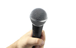 Microphone on a white background. Hand is holding a Microphone on a white background Stock Images