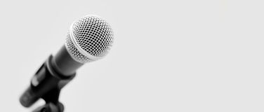 Microphone on a white background. Silver handheld ball head microphone on white background stock photos