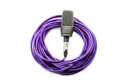 Microphone with wire. Black microphone with wire  on white Royalty Free Stock Image