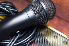 Microphone and wire close-up on a blurred background.  stock photos