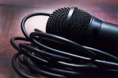 Microphone and wire close-up on a blurred background.  royalty free stock photography