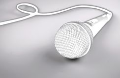Microphone with a wire on white background. Silver mic. Microphone with a wire on white background. Silver professional microphone for studio stock image