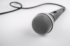 Microphone with a wire on white background. Silver mic. Microphone with a wire on white background. Silver professional microphone for studio royalty free stock image