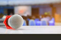 Microphone wireless on a stand in interior meeting room seminar empty conference background. Select focus with shallow depth of field royalty free stock image