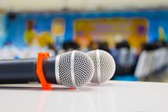 Microphone wireless two Close up in conference seminar room with copy space add text :Select focus with shallow depth of field.  stock image