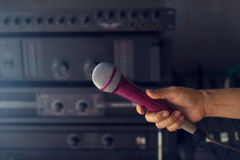 Microphone in woman hand on backstage of concert Stock Images