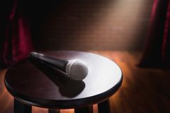 Microphone on a wood stool on a stage royalty free stock photo