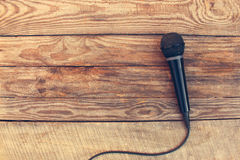 Microphone on wooden background Royalty Free Stock Photo