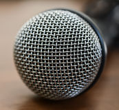 Microphone on wooden table Royalty Free Stock Images