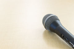 The microphone on the wooden table Stock Photography
