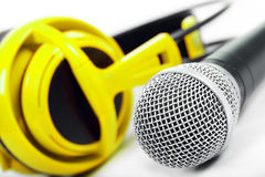 Microphone and yellow headphones Stock Photography