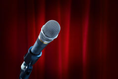 Microphoneon red curtain Royalty Free Stock Image