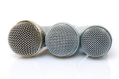Microphones. Gold and silver microphones on the white background Royalty Free Stock Photos