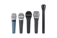 Microphones. Five mikes isolated on white stock photo
