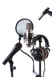 Microphones. Three microphones and headphones is isolated Royalty Free Stock Photos