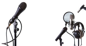 Microphones. Three microphones and headphones is isolated Stock Image