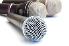 Microphones. Modern scenic microphones on a white background Stock Image