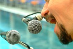 Microphones. Two microphones with a man Stock Image