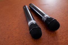 Microphones. Abstract pair of microphones on table Stock Image