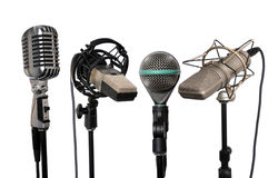 Microphones Aligned. Microphones from vintage to modern aligned together Stock Images