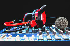 Microphones, audio mixer, headphones. Royalty Free Stock Images