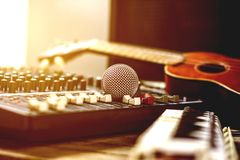 Microphones with audio mixer, sound recorder and old instrument. The microphone on the audio mixer in the studio royalty free stock photography