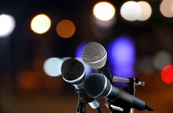 Microphones with blur lights background Royalty Free Stock Photo