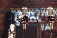Microphones with a brick stage background Stock Photo