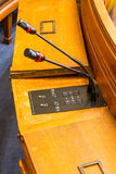 Microphones in conference or council chamber on wood desk. Stock Images