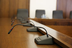 Microphones in conference room Royalty Free Stock Photos