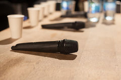 Microphones at conference table Stock Image