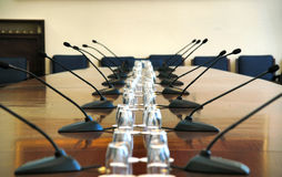 Microphones in empty conference hall Royalty Free Stock Image