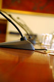 Microphones in empty conference hall. Businnes meeting Stock Image